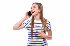 Young Woman Using a Cell Phone. Isolated on White Royalty Free Stock Photo