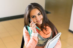 Young woman using cellphone. Closeup of a happy young woman using cellphone Royalty Free Stock Photos