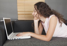 Young woman using computer Stock Photography