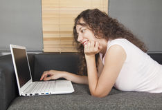 Young woman using computer Stock Image