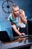 Young woman using computer. And headphone Royalty Free Stock Images
