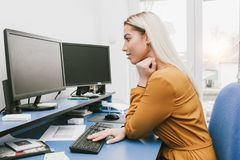 Young woman using computer Royalty Free Stock Images