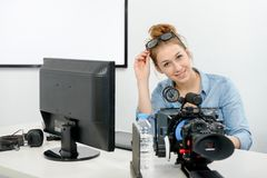 Young woman using computer for video editing. A young woman using computer for video editing royalty free stock photos