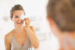 Young woman using with cotton pad in bathroom Royalty Free Stock Photo