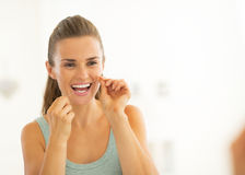 Young woman using dental floss Stock Images