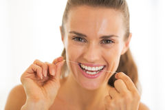 Young woman using dental floss Royalty Free Stock Photography