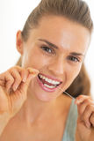 Young woman using dental floss Royalty Free Stock Images