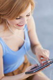 Young woman using digital tablet royalty free stock photo