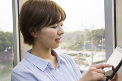 Young woman using a digital tablet Stock Photos