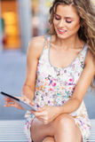 Young woman using digital tablet Stock Images