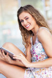Young woman using digital tablet Stock Image