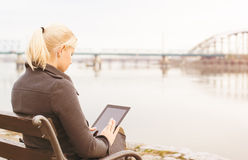 Young woman using a digital tablet. Royalty Free Stock Photography