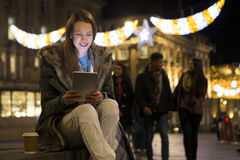 Young woman using a digital tablet in the city Royalty Free Stock Photo