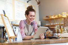 Young woman using digital tablet in coffee shop stock image