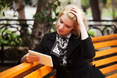 Young woman using a digital tablet computer Royalty Free Stock Image