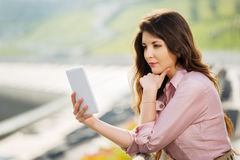 Young fashion woman using a digital tablet computer Royalty Free Stock Images
