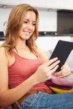 Young Woman Using Digital Tablet At Home Stock Photography