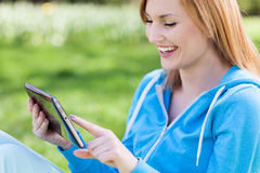 Young woman using digital tablet outdoors Stock Photography
