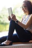 Young woman using digital tablet Stock Photos
