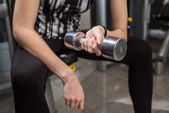 Young woman using dumbbell Stock Photo