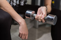 Young woman using dumbbell Stock Image