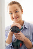 Young Woman Using Electric Drill In House Renovation Project Stock Photos