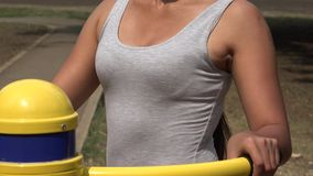 Young Woman Using Exercise Equipment stock footage