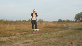 Young woman using first person view headset to operate drone flight stock video