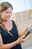 Young woman using hand-held inventory device. Young woman using a hand-held inventory device Royalty Free Stock Photo