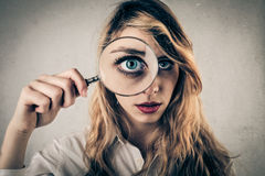 Young woman using a hand lens Stock Photos