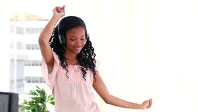 Young woman using headphones while dancing Stock Photo