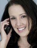 Young woman using her cell phone Royalty Free Stock Photography