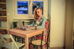 Young woman using her laptop Stock Image