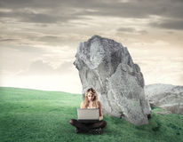 Young woman using her laptop Royalty Free Stock Photography