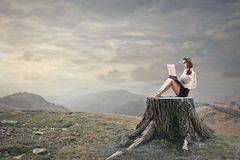 Young woman using her laptop royalty free stock photo