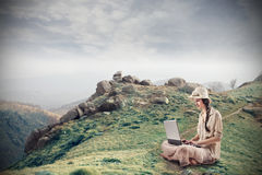 Young woman using her laptop Royalty Free Stock Images