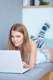 Young woman using her laptop at home Royalty Free Stock Image