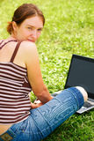 Young woman using her laptop outdoors. Beautiful young woman using her laptop outdoors Stock Photography