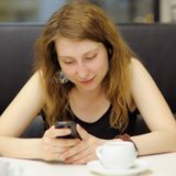 Young woman using her mobile phone Stock Photography