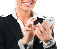 Young woman using her mobile phone for texting Stock Photos