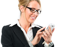 Young woman using her mobile phone for texting Royalty Free Stock Image