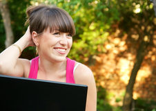 Young woman using her notebook Stock Image