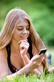 Young woman using her pda Stock Images