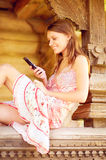 Young woman using her phone Royalty Free Stock Photography