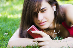 Young woman using her phone Stock Photo