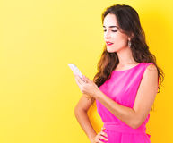 Young woman using her phone Royalty Free Stock Photo