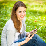 Young woman using her tablet computer Stock Photos