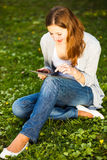 Young woman using her tablet computer Royalty Free Stock Photo