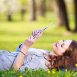 Young woman using her tablet computer Stock Photo