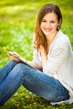 Young woman using her tablet computer Stock Image